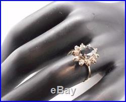 Ancienne Bague en or blanc18 carats sertie d'un saphir et diamants