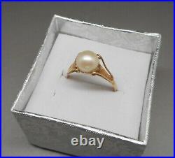 Ancienne bague en or 18 carats sertie d'une perle de culture