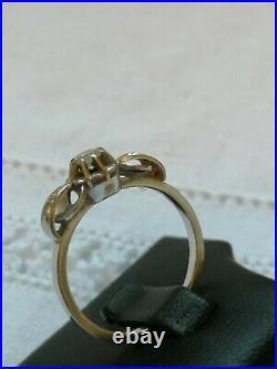 Bague ancienne en or blanc et platine sertie de 3 diamants