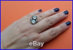 Bague ancienne en or gris et platine ornée de quatre gros diamants