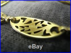 Bracelet ancien Art Nouveau années 20 volutes fleurs en or 18 carats