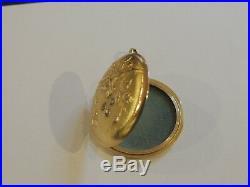 Pendentif or 18 carats ancien ouvrant époque 1900 serti de 3 roses en diamant